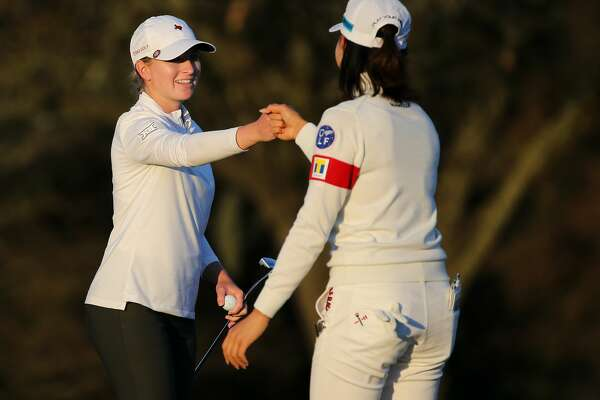 Kaitlyn Papp, left, congratulates Hinako Shibuno after the two finished the third round of the 75th Annual U.S. Women's Open on the Cypress Creek Course at Champions Golf Club in Houston on Saturday, Dec. 12, 2020.