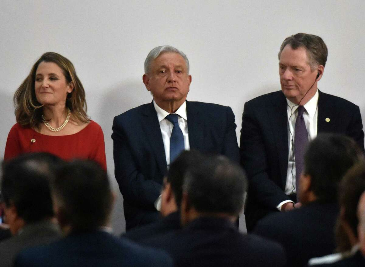 Mexican President Andres Manuel Lopez Obrador with United States Trade Representative Robert Lighthizer (R) and Canadian Vice-Prime Minister Chrystia Freeland in Mexico City in 2019. U.S energy companies say the Lopez Obrador government has violated at least the spirit of the U.S. Mexico Canada Agreement by undermining Mexico's energy reforms to favor the old state-owned energy companies over new foreign competitors.
