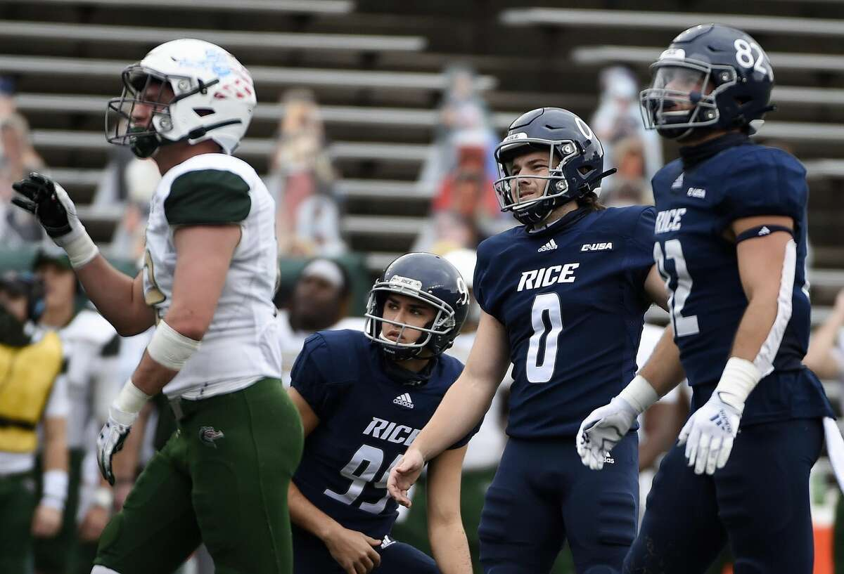 Rice place kicker Collin Riccitelli (0), placeholder Charlie Mendes (99), and tight end Jaeger Bull (82) watch Riccitelli's field goal connect during the first half of an NCAA college football game against UAB, Saturday, Dec. 12, 2020, in Houston.