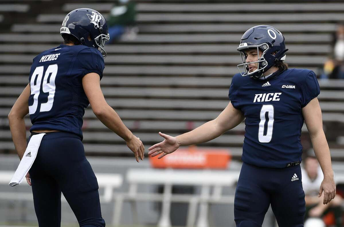 Rice place kicker Collin Riccitelli (0) celebrates his field goal with placeholder Charlie Mendes during the second half of an NCAA college football game against UAB, Saturday, Dec. 12, 2020, in Houston.