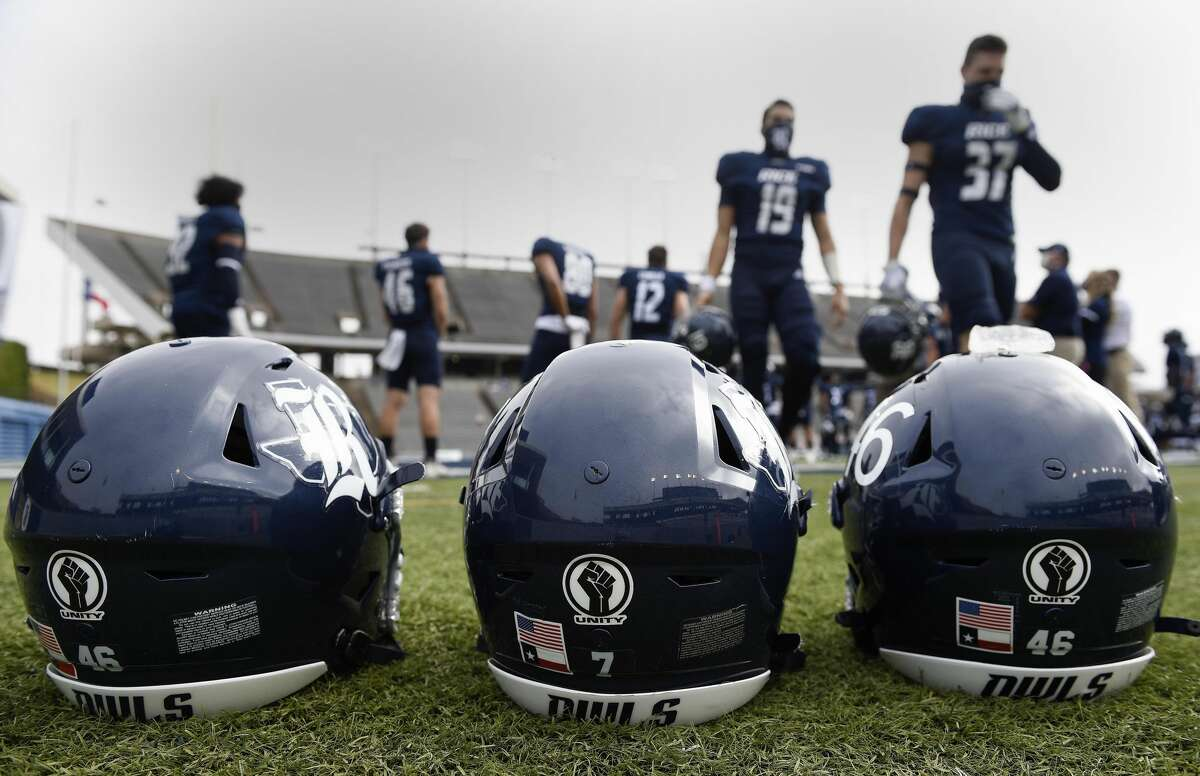 Rice seniors' helmets are seen with 'Unity' stickers before an NCAA college football game against UAB, Saturday, Dec. 12, 2020, in Houston.