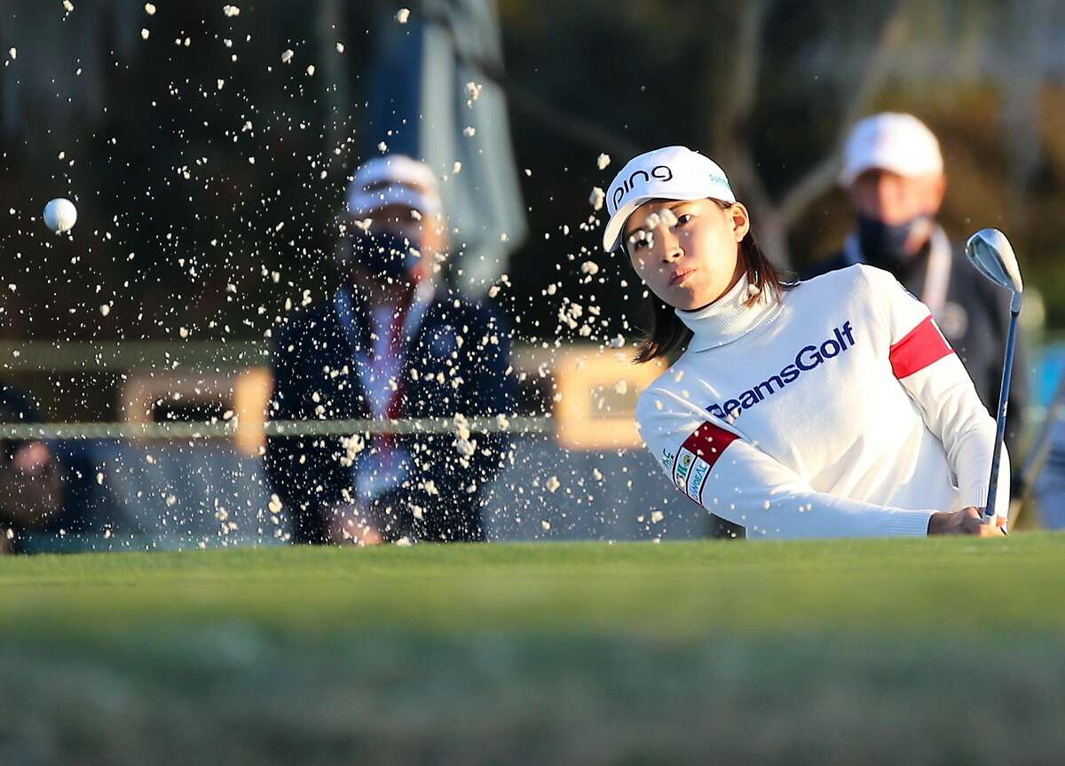 Hinako Shibuno gets the ball out of the bunker on the 18th hole during the third round of the U.S. Women's Open in Houston.