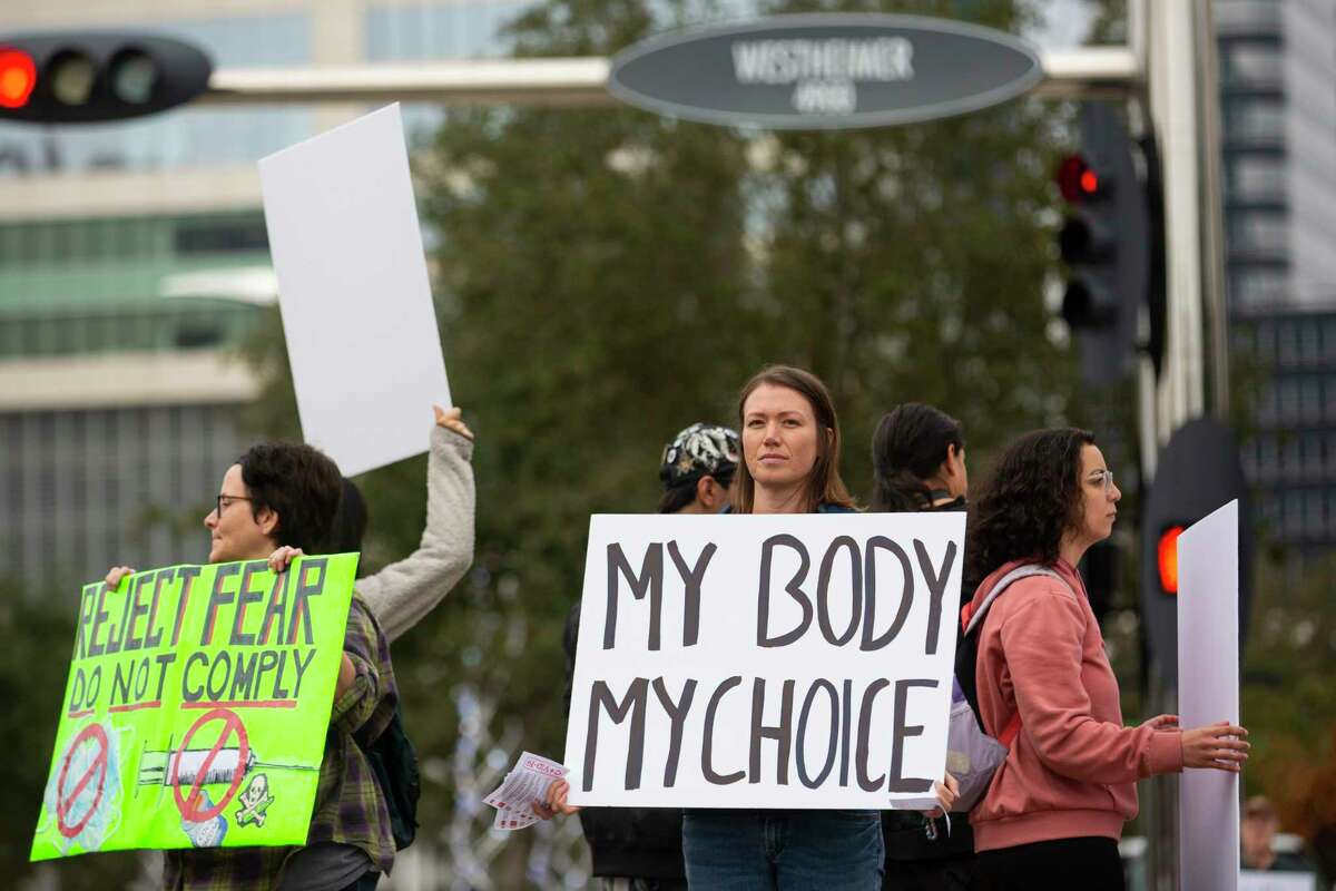 Kaydance Christensen protests during traffic at the intersection of Westheimer and Post Oak Blvd. during the Rally for Covid-19 Liberty, Health, and Choice on Saturday, Dec. 12, 2020.