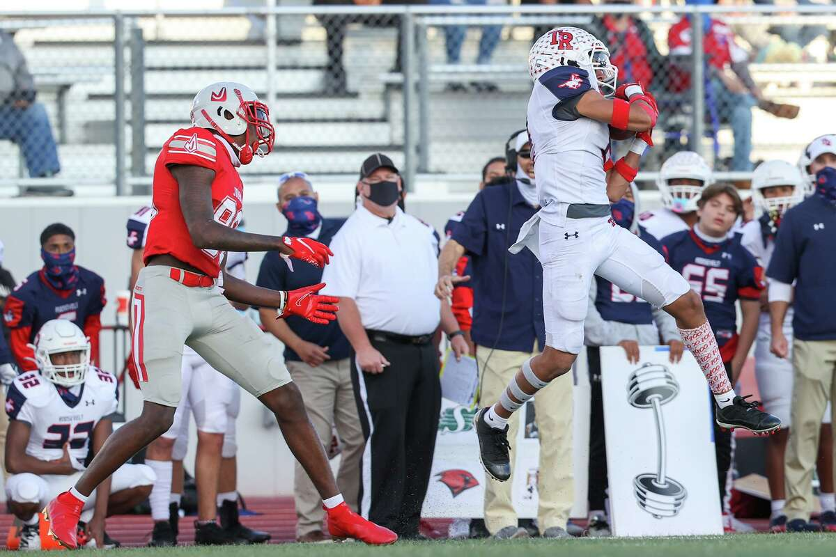 Roosevelt's Lavon Williams, right, intercepts a pass intended for Judson's Davion Wilson to effectively seal their victory over the Rockets during the second half of their Class 6A Division II first round high school football playoff game at Rutledge Stadium on Saturday, Dec. 12, 2020. Roosevelt beat Judson 28-21.