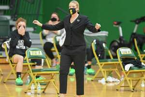Siena College coach Ali Jaques directs her team from in front of a socially distanced bench during a Metro Atlantic Athletic Conference game against Fairfield University at Siena College in Loudonville, NY, on Saturday, Dec. 12, 2020 (Jim Franco/special to the Times Union.)