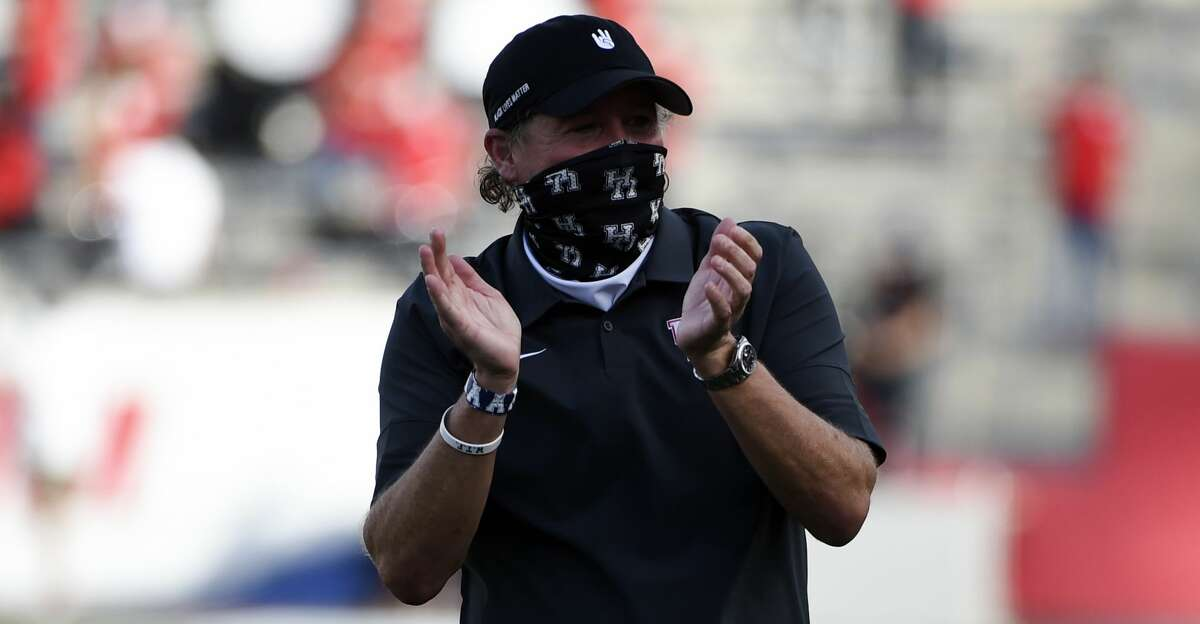 Houston head coach Dana Holgorsen claps after the team's touchdown during the first half of an NCAA college football game against against South Florida, Saturday, Nov. 14, 2020, in Houston. (AP Photo/Eric Christian Smith)