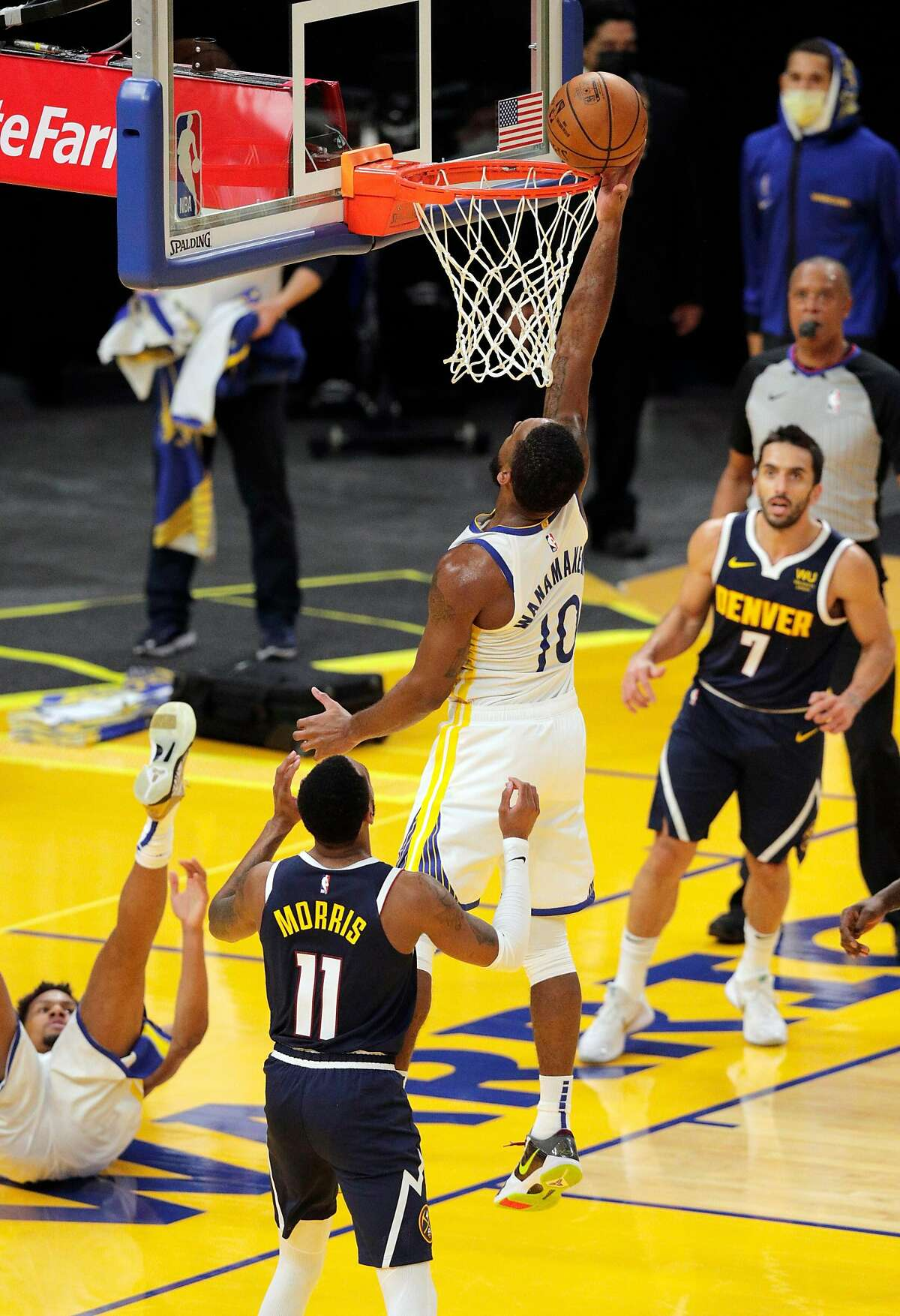 Brad Wanamaker (10) follows up on a shot by Axel Toupane (66) during the first half as the Golden State Warriors played the Denver Nuggets in their first preseason game at Chase Arena in San Francisco, Calif., on Saturday, December 12, 2020.