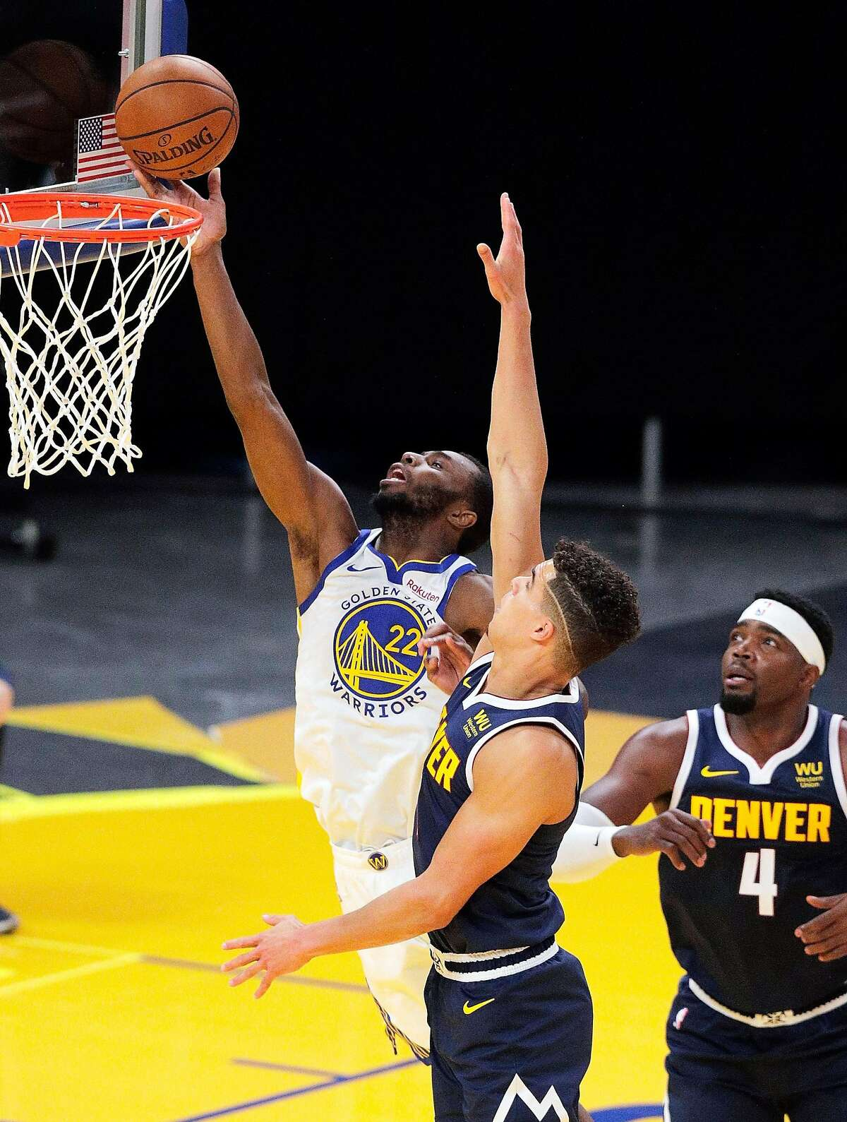 Andrew Wiggins (22) puts up a shot during the first half as the Golden State Warriors played the Denver Nuggets in their first preseason game at Chase Arena in San Francisco, Calif., on Saturday, December 12, 2020.
