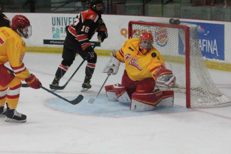Ferris State goalie Roni Salmenkangas tries to secure the loose puck during a Bowling Green power play on Saturday. (Pioneer photo/John Raffel)
