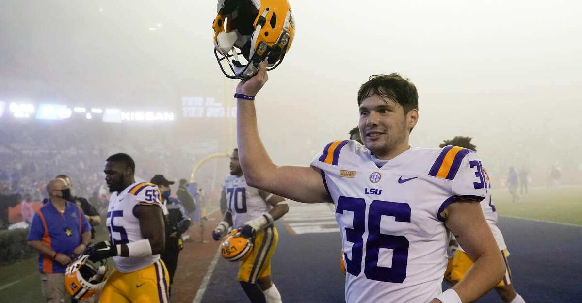LSU's Cade York (36) celebrates as he comes off the field after kicking a field goal against Florida in the final minute of an NCAA college football gam Saturday, Dec. 12, 2020, in Gainesville, Fla. LSU won 37-34. (AP Photo/John Raoux)
