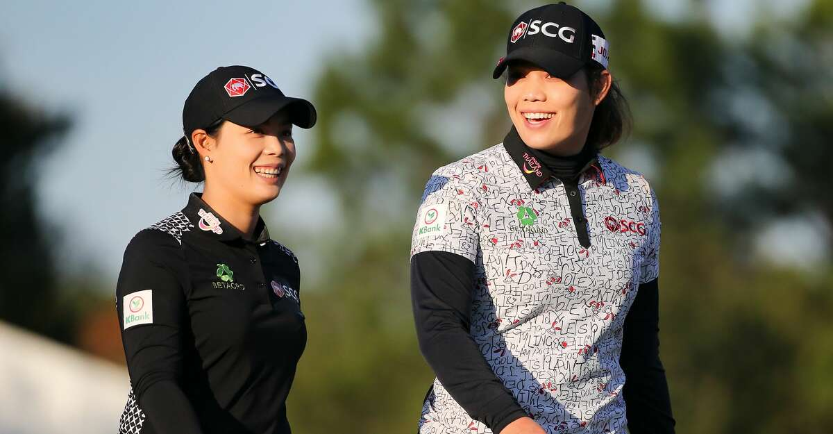 Sisters Moriya, left, and Ariya Jutanugarn of Thailand laugh after finishing the third round of the 75th Annual U.S. Women's Open on the Cypress Creek Course at Champions Golf Club in Houston on Saturday, Dec. 12, 2020.