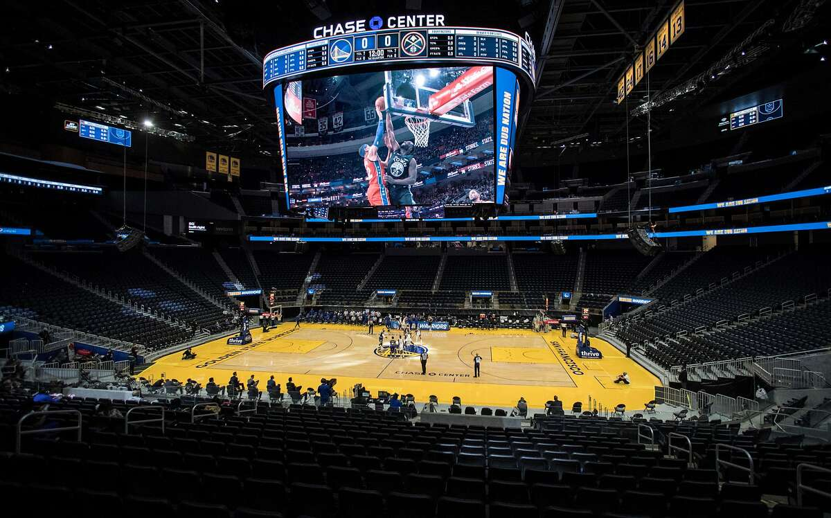 The Chase Arena is empty except for team personnel and media during the first half as the Golden State Warriors played the Denver Nuggets in their first preseason game at Chase Arena in San Francisco, Calif., on Saturday, December 12, 2020.