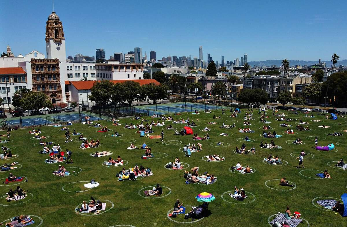 The social distancing circles at Dolores Park on Saturday, May 23, 2020, in San Francisco, Calif. The Recreation and Parks Department painted the grass with social distancing circles. The 10-foot circles, which are eight-feet apart from each other, is an effort to curb coronavirus spread.