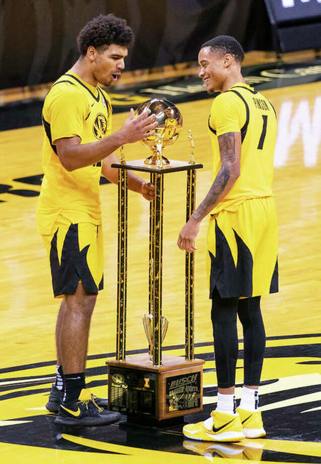 Missouri's Mark Smith (left) and Xavier Pinson admire the Braggin' Rights trophy on the Mizzou Arena court after the Tigers defeated Illinois 81-78 in the annual Braggin' Rights game Saturday night in Columbia, Mo. Photo: Associated Press