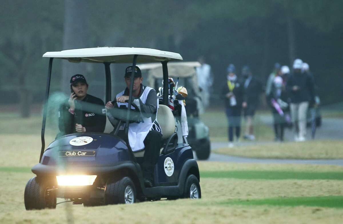 Golfers and caddies make their way off the course after a weather warming during the final round of the 75th Annual U.S. Women's Open on the Cypress Creek Course at Champions Golf Club in Houston on Sunday, Dec. 13, 2020.