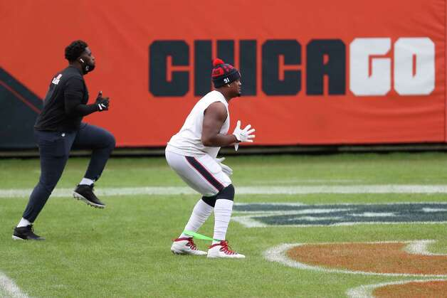 Houston Texans nose tackle Brandon Dunn (92) and defensive end Carlos Watkins (91) warm up before an NFL football game against the Chicago Bears at Soldier Field Sunday, Dec. 13, 2020, in Chicago. Photo: Brett Coomer, Staff Photographer / © 2020 Houston Chronicle