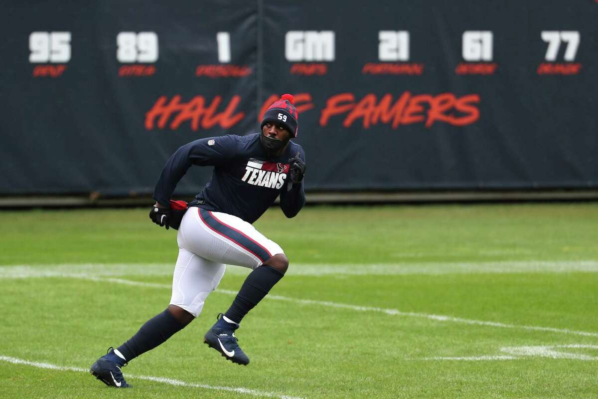 Houston Texans outside linebacker Whitney Mercilus warms up before an NFL football game against the Chicago Bears at Soldier Field Sunday, Dec. 13, 2020, in Chicago.