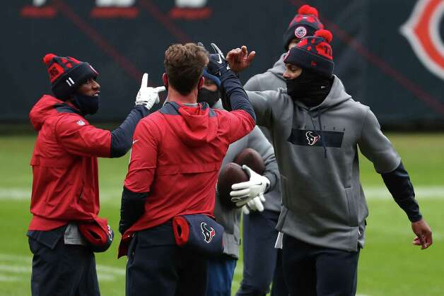 Houston Texans quarterback Deshaun Watson, right, high fives his teammates after warming up before an NFL football game against the Chicago Bears at Soldier Field Sunday, Dec. 13, 2020, in Chicago. Photo: Brett Coomer, Staff Photographer / © 2020 Houston Chronicle