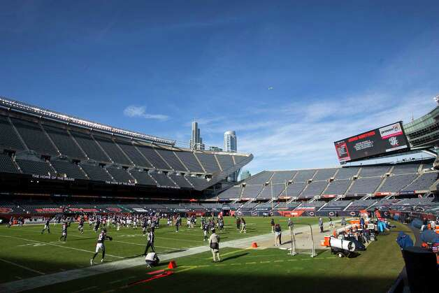 The Houston Texans and Chicago Bears warm up in front of an empty stadium, due to Covid-19 restrictions, before an NFL football game at Soldier Field Sunday, Dec. 13, 2020, in Chicago. Photo: Brett Coomer, Staff Photographer / © 2020 Houston Chronicle