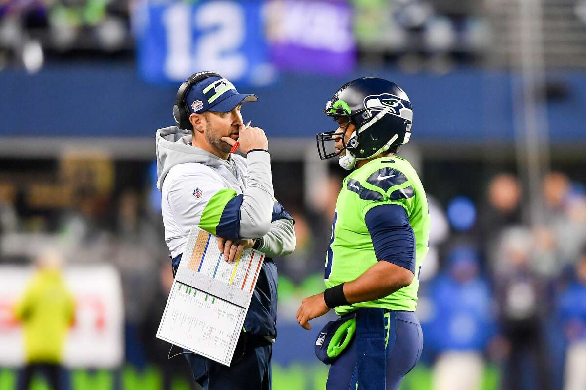 SEATTLE, WASHINGTON - DECEMBER 02: Russell Wilson #3 of the Seattle Seahawks, right, has a chat with offensive coordinator Brian Schottenheimer during the game against the Minnesota Vikings at CenturyLink Field on December 02, 2019 in Seattle, Washington. The Seattle Seahawks won, 37-30. (Photo by Alika Jenner/Getty Images)