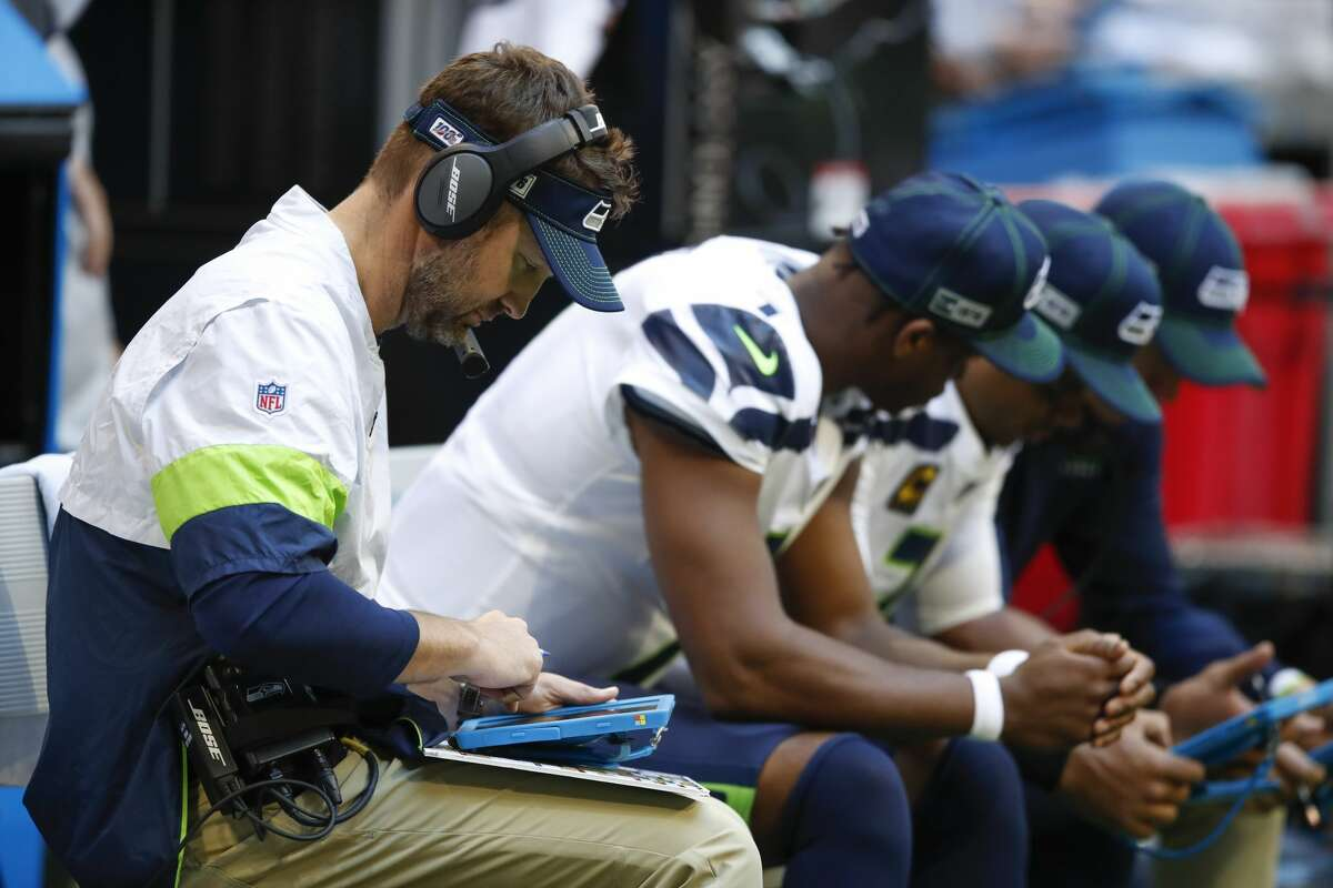 ATLANTA, GA - OCTOBER 27: Offensive Coordinator Brian Schottenheimer of the Seattle Seahawks sits with his quarterbacks in the second half of an NFL game against the Atlanta Falcons at Mercedes-Benz Stadium on October 27, 2019 in Atlanta, Georgia. (Photo by Todd Kirkland/Getty Images)