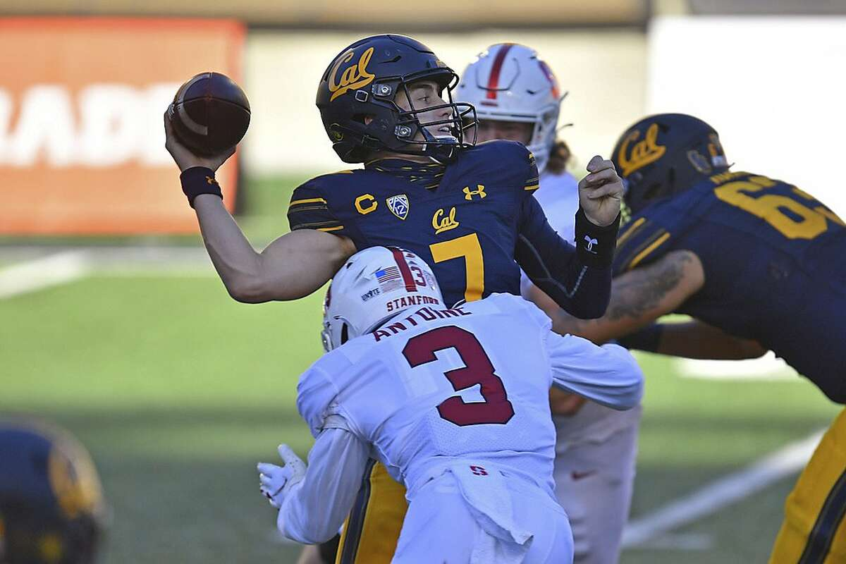 California quarterback Chase Garbers (7) is sacked by Stanford's Malik Antoine (3) during the second quarter of an NCAA college football game Friday, Nov. 27, 2020, in Berkeley, Calif. (Jose Carlos Fajardo/Bay Area News Group via AP)
