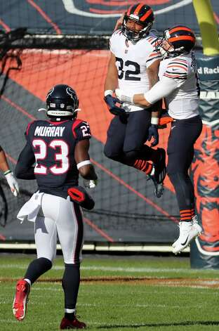 Chicago Bears running back David Montgomery (32) and Chicago Bears quarterback Mitchell Trubisky (10) celebrate Montgomery's 80-yard touchdown run against the Houston Texans on their first offensive of the game during the first quarter of an NFL football game at Soldier Field Sunday, Dec. 13, 2020, in Chicago. Photo: Brett Coomer, Staff Photographer / © 2020 Houston Chronicle