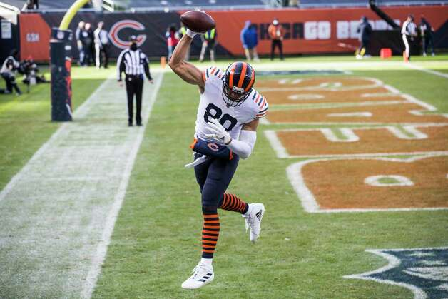 Chicago Bears tight end Jimmy Graham (80) spikes the ball as he celebrates his a 5-yard touchdown reception against the Houston Texans during the first half of an NFL football game at Soldier Field Sunday, Dec. 13, 2020, in Chicago. Photo: Brett Coomer, Staff Photographer / © 2020 Houston Chronicle