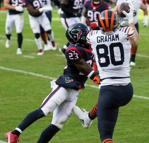 Chicago Bears tight end Jimmy Graham (80) leaps over Houston Texans free safety Eric Murray (23) for a 5-yard touchdown reception during the first half of an NFL football game at Soldier Field Sunday, Dec. 13, 2020, in Chicago. Photo: Brett Coomer, Staff Photographer / © 2020 Houston Chronicle