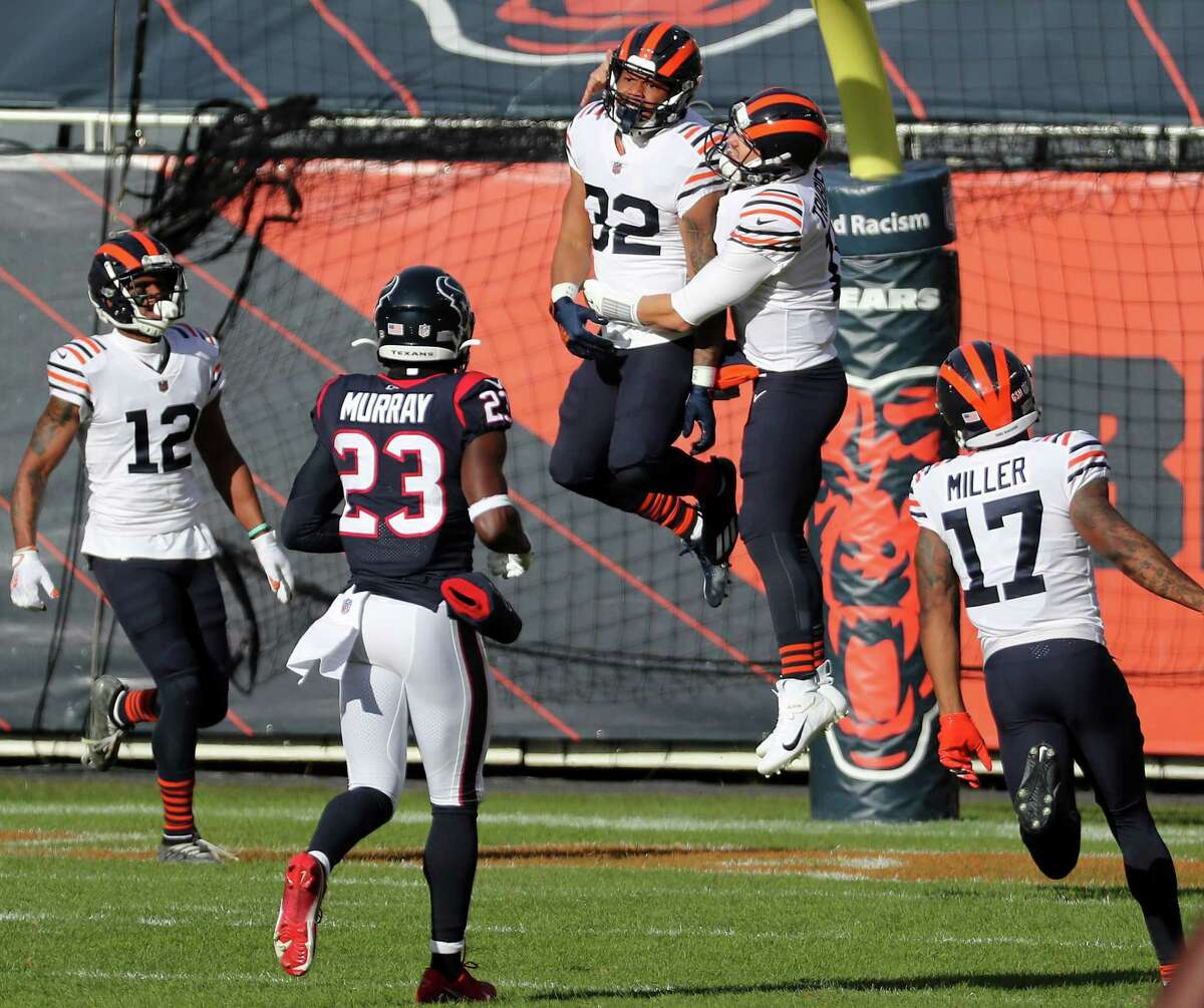 Chicago Bears running back David Montgomery (32) and Chicago Bears quarterback Mitchell Trubisky (10) celebrate Montgomery's 80-yard touchdown run against the Houston Texans on their first offensive of the game during the first quarter of an NFL football game at Soldier Field Sunday, Dec. 13, 2020, in Chicago.