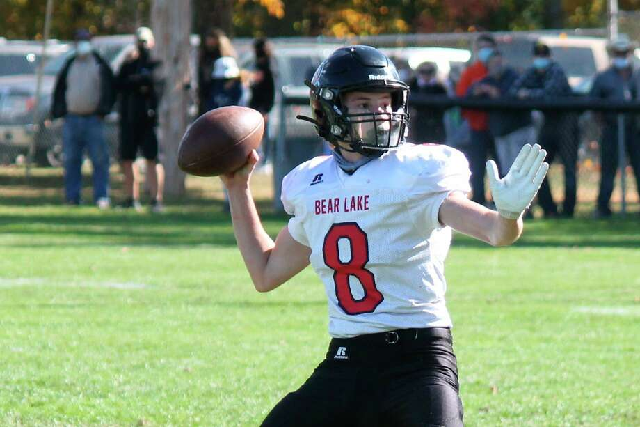 Tate Aultman looks to pass the ball downfield during a game against Mesick on Oct. 10. (File photo)