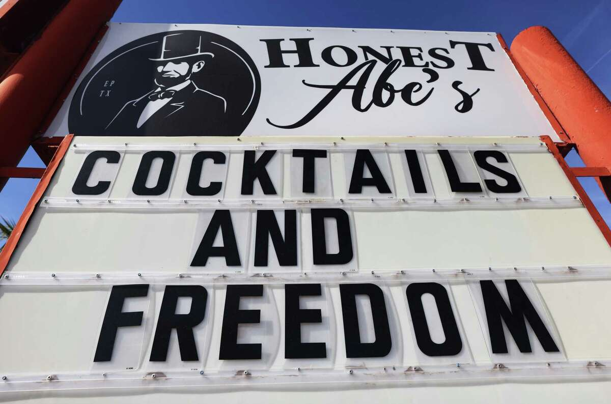 EL PASO, TEXAS - NOVEMBER 22: An indoor bar which is open displays a sign reading 'Cocktails and Freedom' amid a COVID-19 surge in the city on November 22, 2020 in El Paso, Texas. Texas surpassed 20,000 confirmed coronavirus deaths November 16, the second highest in the U.S., with active cases in El Paso now over 35,000 and confirmed COVID-19 deaths at 855. In spite of the recent spike in cases and deaths, Texas Gov. Greg Abbott recently stated to Dallas radio host Mark Davis 'We are not going to have any more lockdowns in the state of Texas'. A recent analysis by the Washington Post of cell phone data reports that states which reopened their bars had a doubling of cases of COVID-19 just three weeks later. (Photo by Mario Tama/Getty Images)