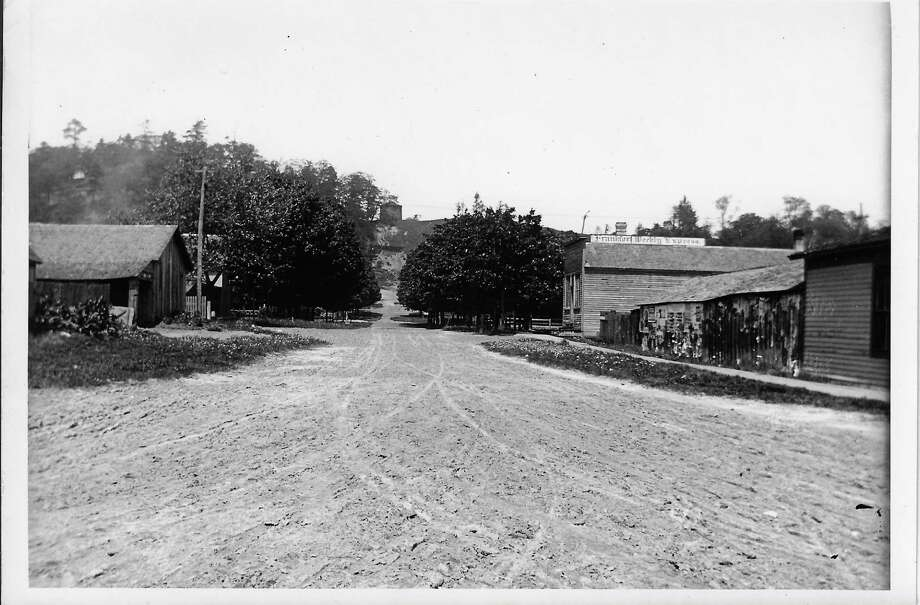 Looking north up 4th Street in Frankfort about 1890. On the right is the original building of the Frankfort Weekly Express before it exploded, with the boiler landing at the Butler sawmill, 3 blocks away. (Courtesy Photo)