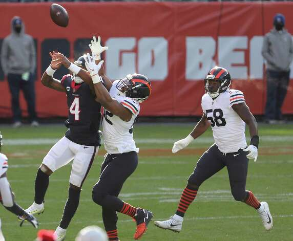 Houston Texans quarterback Deshaun Watson (4) and Chicago Bears outside linebacker Khalil Mack (52) leap up for a pass blocked by Mack during the second quarter of an NFL football game at Soldier Field Sunday, Dec. 13, 2020, in Chicago. Watson knocked the ball to the turf for an incomplete pass. Photo: Brett Coomer, Staff Photographer / © 2020 Houston Chronicle
