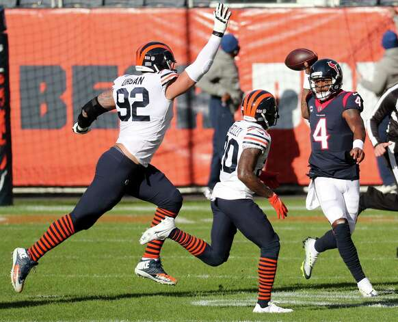 Houston Texans quarterback Deshaun Watson (4) throws the ball away as he is chased out of the pocket by Chicago Bears defensive end Brent Urban (92) and cornerback Duke Shelley (20) during the first quarter of an NFL football game at Soldier Field Sunday, Dec. 13, 2020, in Chicago. Photo: Brett Coomer, Staff Photographer / © 2020 Houston Chronicle