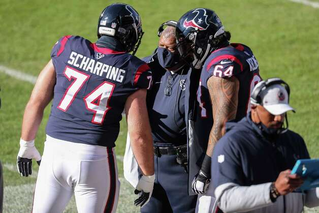 Houston Texans head coach Romeo Crennel talks to offensive guards Max Scharping (74) and Senio Kelemete (64) on the sidelines during the first quarter of an NFL football game at Soldier Field Sunday, Dec. 13, 2020, in Chicago. Photo: Brett Coomer, Staff Photographer / © 2020 Houston Chronicle