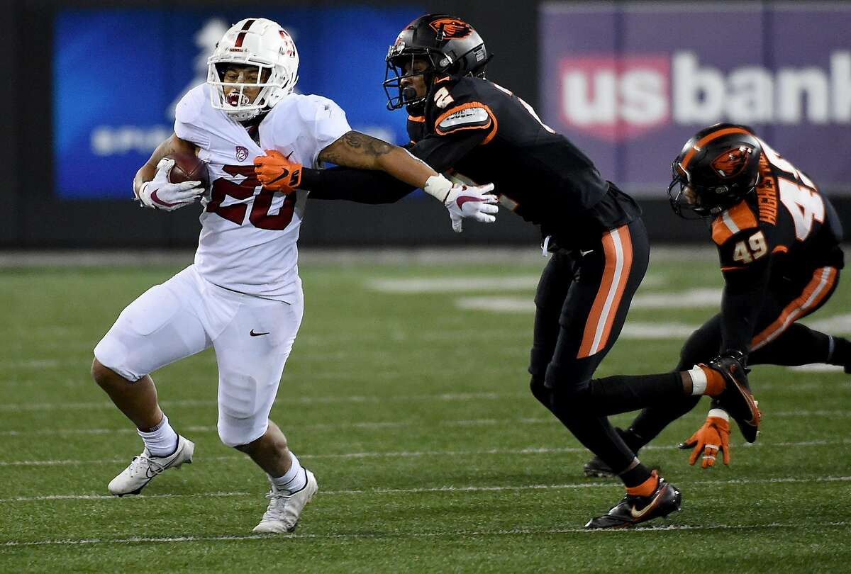 Stanford running back Austin Jones tries to get away from the tackle of Oregon State defensive back Nahshon Wright.