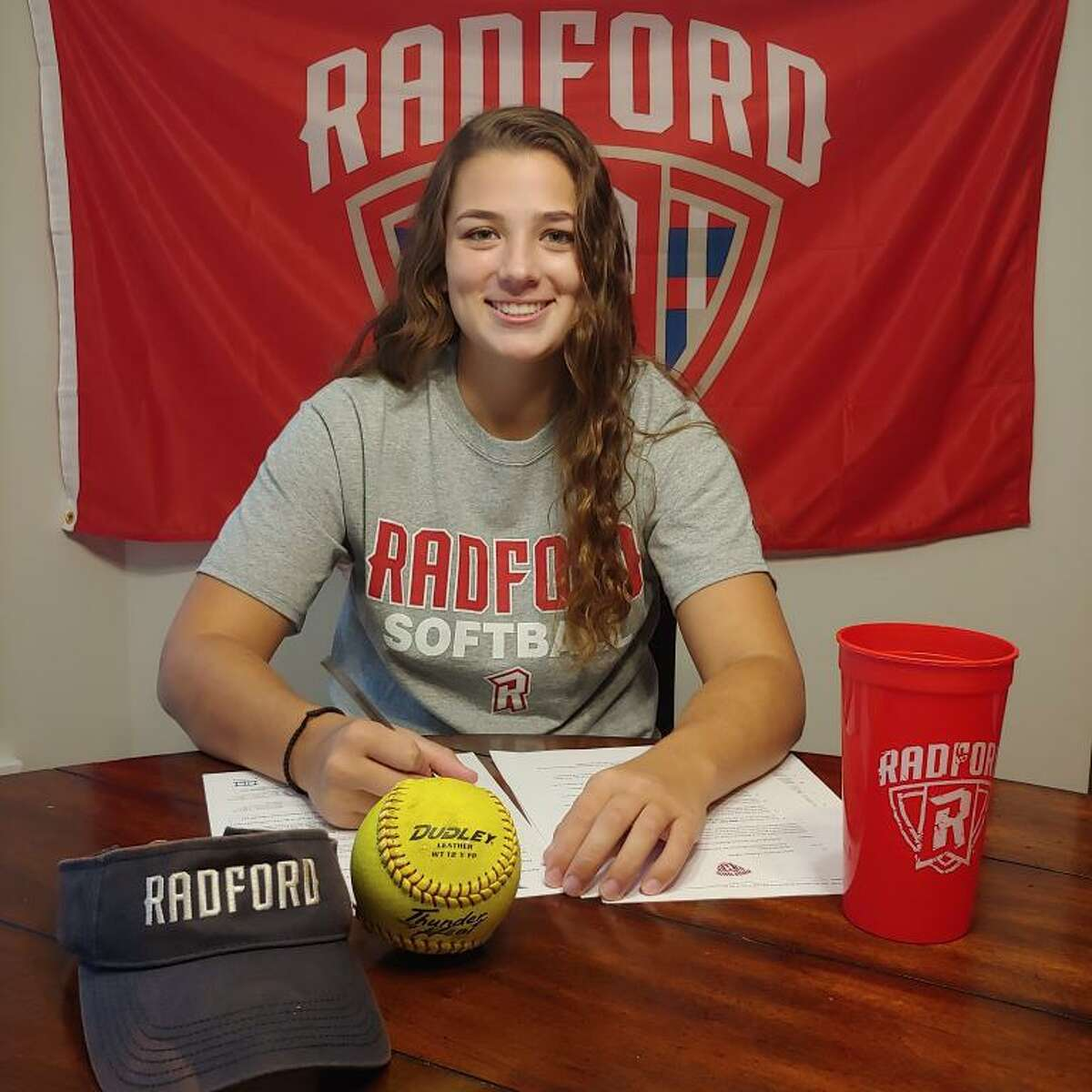 Trumbull's Cassi Barbato signs her National Letter of Intent to play Division I softball at Radford (Va.) University.