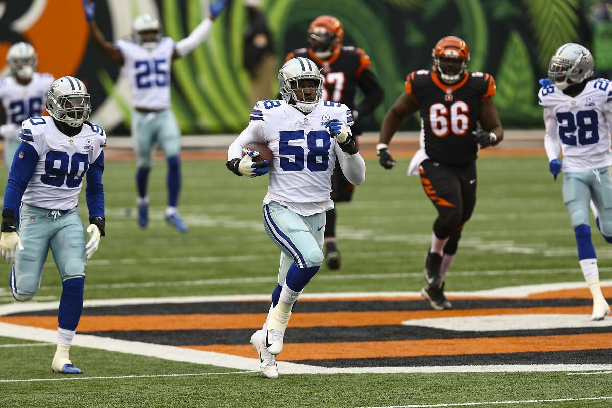 Dallas Cowboys defensive end Aldon Smith (58) returns a fumble for a touchdown in the first half of an NFL football game against the Cincinnati Bengals in Cincinnati, Sunday, Dec. 13, 2020. (AP Photo/Aaron Doster)