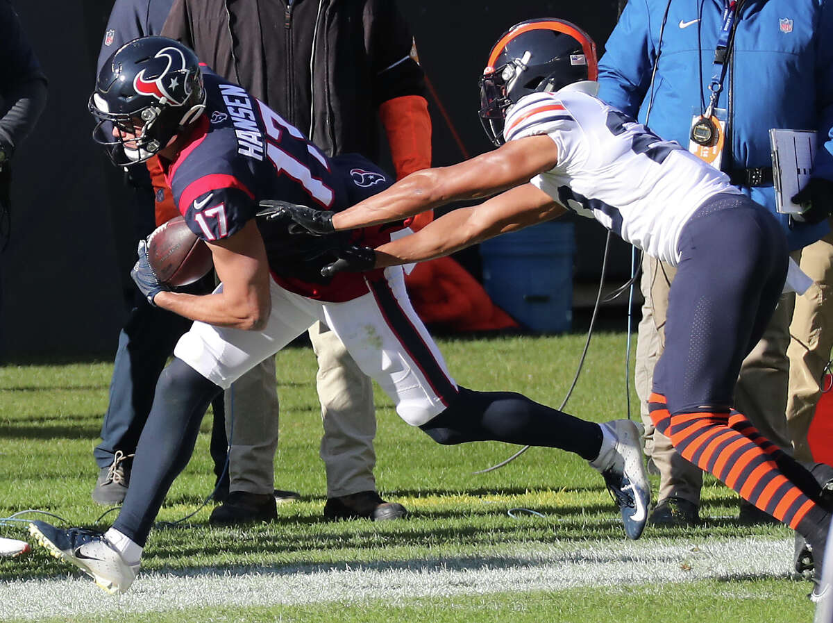 Houston Texans wide receiver Chad Hansen (17) is pushed out of bounds by Chicago Bears cornerback Kyle Fuller (23) during the first quarter of an NFL football game at Soldier Field Sunday, Dec. 13, 2020, in Chicago.