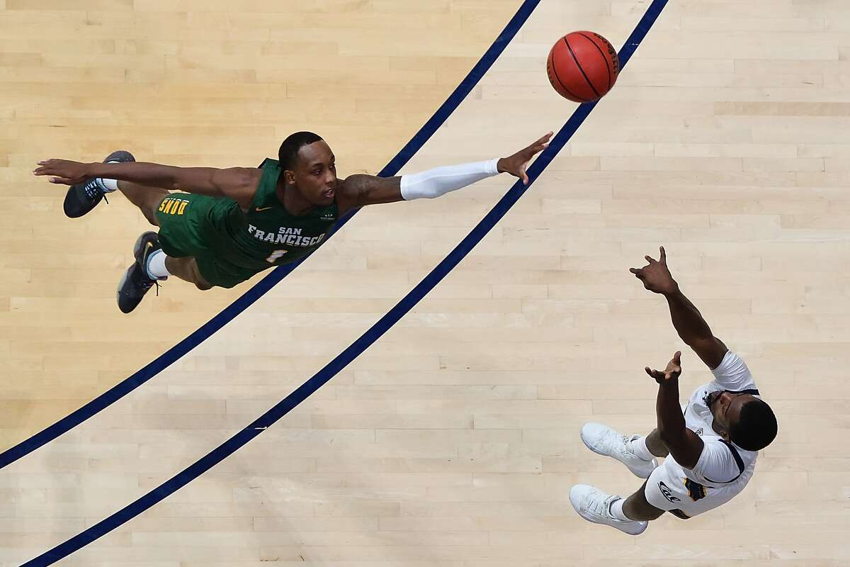Cal's Makale Foreman shoots the game-winning 3-pointer over USF's Jamaree Bouyea. Those were Foreman's lone points of the afternoon. Bouyea scored a game-high 24.