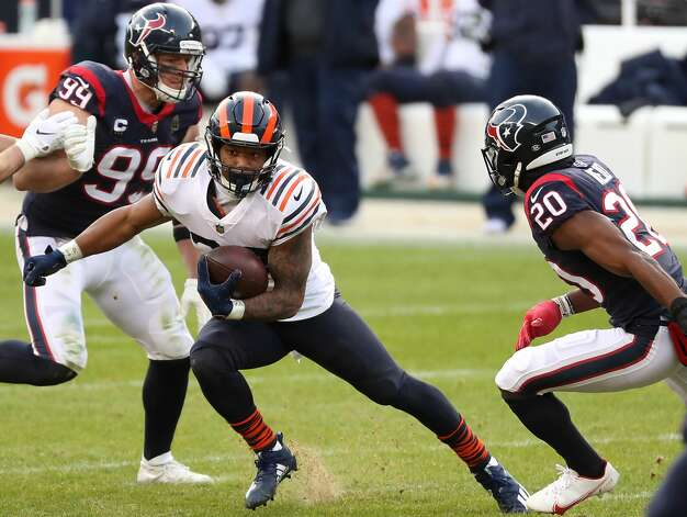 Chicago Bears running back David Montgomery (32) cuts away from. Houston Texans strong safety Justin Reid (20) during the second half of an NFL football game at Soldier Field Sunday, Dec. 13, 2020, in Chicago. Photo: Brett Coomer/Staff Photographer / © 2020 Houston Chronicle
