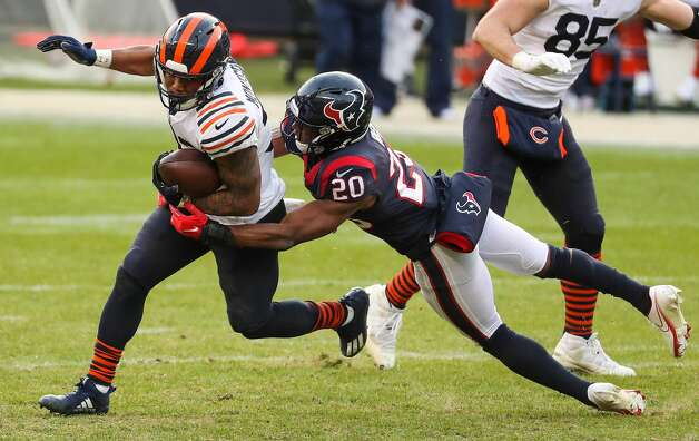 Chicago Bears running back David Montgomery (32) is stopped by Houston Texans strong safety Justin Reid (20) during the second half of an NFL football game at Soldier Field Sunday, Dec. 13, 2020, in Chicago. Photo: Brett Coomer/Staff Photographer / © 2020 Houston Chronicle
