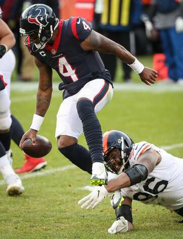 Houston Texans quarterback Deshaun Watson (4) is hit by Chicago Bears defensive end Akiem Hicks (96) during the second half of an NFL football game at Soldier Field Sunday, Dec. 13, 2020, in Chicago. Watson escaped the initial hit by Hicks, but was sacked later in the play. Photo: Brett Coomer/Staff Photographer / © 2020 Houston Chronicle