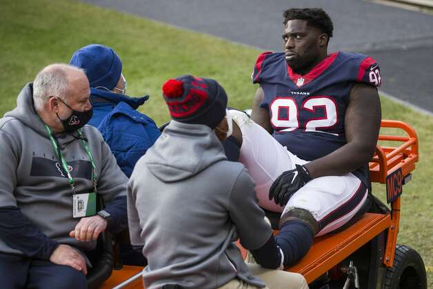 Houston Texans nose tackle Brandon Dunn (92) is carted off the field after suffering an injury against the Chicago Bears during the second half of an NFL football game at Soldier Field Sunday, Dec. 13, 2020, in Chicago. Photo: Brett Coomer/Staff Photographer / © 2020 Houston Chronicle