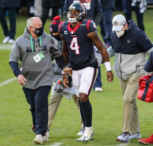 Houston Texans quarterback Deshaun Watson (4) walks off the field with team medical personnel after he was injured during the second half of an NFL football game against the Chicago Bears at Soldier Field Sunday, Dec. 13, 2020, in Chicago. Photo: Brett Coomer/Staff Photographer / © 2020 Houston Chronicle