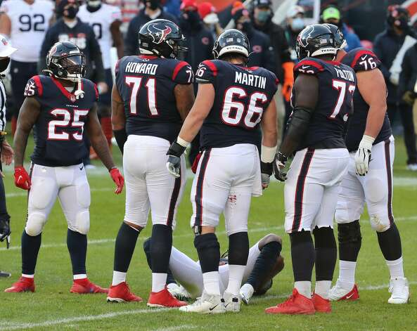 Houston Texans quarterback Deshaun Watson (4) lies on the turf after suffering an injury during the second half of an NFL football game at Soldier Field Sunday, Dec. 13, 2020, in Chicago. Photo: Brett Coomer/Staff Photographer / © 2020 Houston Chronicle