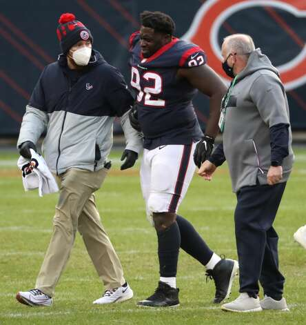 Houston Texans nose tackle Brandon Dunn (92) walks off the field with team medical personnel after suffering an injury against the Chicago Bears during the second half of an NFL football game at Soldier Field Sunday, Dec. 13, 2020, in Chicago. Photo: Brett Coomer/Staff Photographer / © 2020 Houston Chronicle