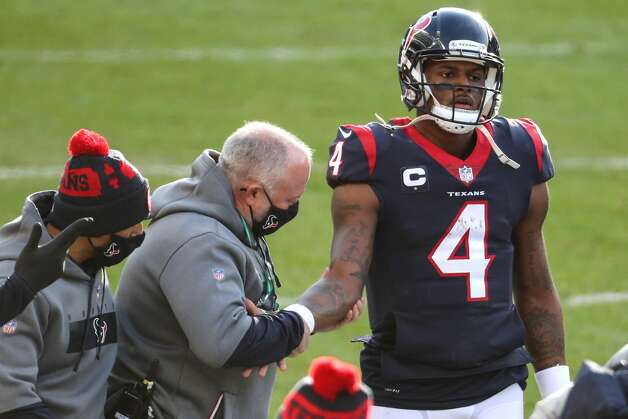 Houston Texans quarterback Deshaun Watson (4) has his arm examined by team physician Dr. Walker Lowe during the second half of an NFL football game against the Chicago Bears at Soldier Field Sunday, Dec. 13, 2020, in Chicago. Photo: Brett Coomer/Staff Photographer / © 2020 Houston Chronicle