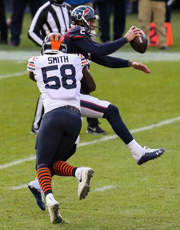 Houston Texans quarterback AJ McCarron (2) is sacked by Chicago Bears inside linebacker Roquan Smith (58) during the second half of an NFL football game at Soldier Field Sunday, Dec. 13, 2020, in Chicago. Photo: Brett Coomer/Staff Photographer / © 2020 Houston Chronicle